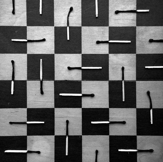 burnt matches in black and white Alexey Menschikov