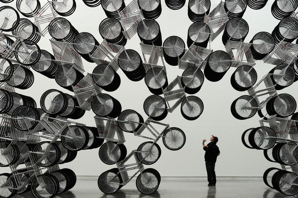 "A man admires an art work entitled ""Fore"
