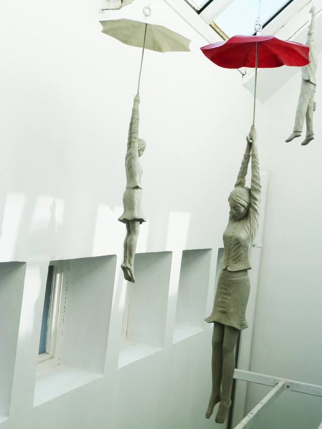 Cement People dangling from umbrellas Michal Trpak 2