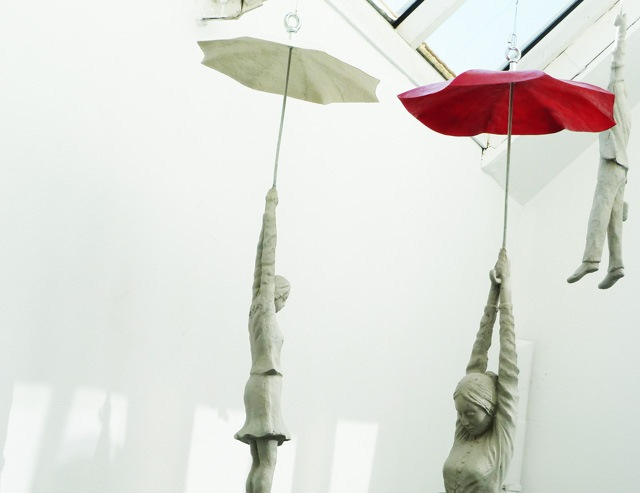 Cement People dangling from umbrellas Michal Trpak 7